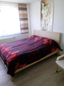 A bed or beds in a room at Appartement Willmeroth