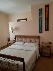 A bed or beds in a room at Bed and Breakfast Gigi e Antonella