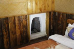 A bed or beds in a room at Vamoose Cherry Village Resort