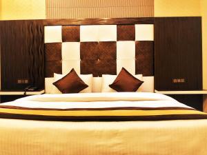 Cama o camas de una habitación en Hotel Pardesi's