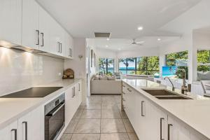 A kitchen or kitchenette at The Lookout Resort Noosa