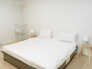 A bed or beds in a room at A-Port