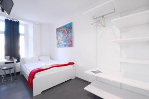 Ein Bett oder Betten in einem Zimmer der Unterkunft HITrental Station Apartments