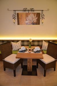 Ein Restaurant oder anderes Speiselokal in der Unterkunft Apartmenthaus Bader