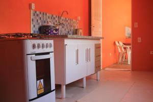 A cozinha ou cozinha compacta de Pousada Sol do Araçá