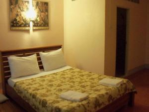 Ein Bett oder Betten in einem Zimmer der Unterkunft D's Corner & Guesthouse