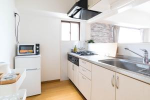 セントレージアーク心斎橋にあるキッチンまたは簡易キッチン