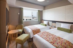 Letto o letti in una camera di HOTEL MYSTAYS Kyoto Shijo