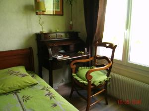 A seating area at Chambre d'hôtes - Garibaldi