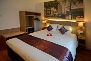 Een bed of bedden in een kamer bij Best Western City Hotel Woerden
