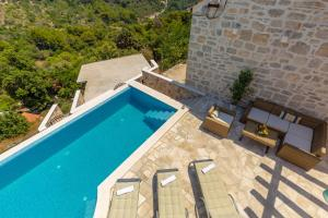 A view of the pool at Villa Klacina or nearby