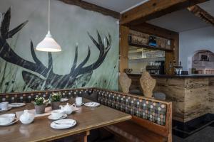 Ein Restaurant oder anderes Speiselokal in der Unterkunft s´Amagmach