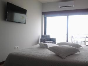 A bed or beds in a room at Guest House A&z