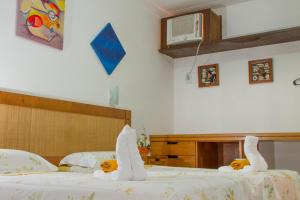 A bed or beds in a room at Pousada Mares Do Forte