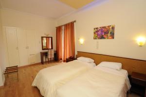 Ένα ή περισσότερα κρεβάτια σε δωμάτιο στο Byzantion Hotel