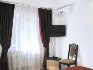 Телевизор и/или развлекательный центр в Отель Столичная