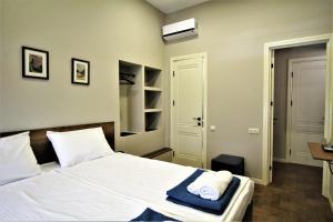 Кровать или кровати в номере Hotel Loft