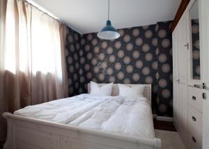 Ein Bett oder Betten in einem Zimmer der Unterkunft Ellena`s FEWO am Uke