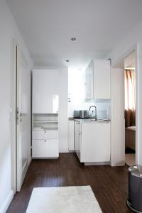 Küche/Küchenzeile in der Unterkunft Ellena`s FEWO am Uke