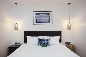 Ein Bett oder Betten in einem Zimmer der Unterkunft Oriental Heritage Residence