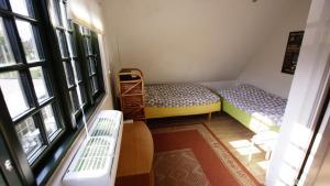 En eller flere senge i et værelse på Guesthause Fensmark Helge sahl