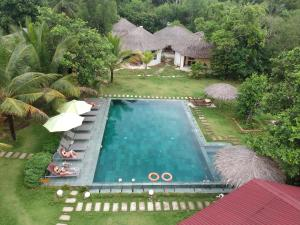 A view of the pool at Ninila Fruit Farm Bungalow or nearby