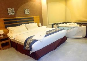 Cama ou camas em um quarto em Green Pearl Resort