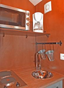 A kitchen or kitchenette at Domaine de La Mésange