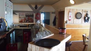 Een keuken of kitchenette bij De Kabbelaar