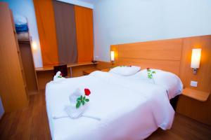 A bed or beds in a room at Ibis Meknes