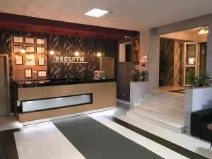 The lobby or reception area at Hotel Gala