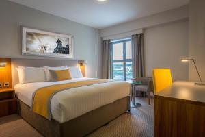 A bed or beds in a room at Maldron Hotel & Leisure Centre Limerick