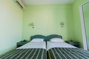 Ένα ή περισσότερα κρεβάτια σε δωμάτιο στο Hotel Venetia