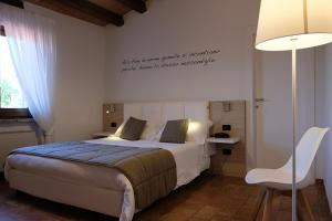 A bed or beds in a room at Relais Madonna di Campagna