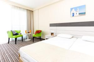 A bed or beds in a room at Christofinia Hotel