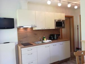 Kuchyň nebo kuchyňský kout v ubytování Gästehaus Bergwelt