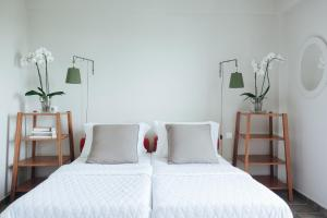A bed or beds in a room at Emelisse Nature Resort