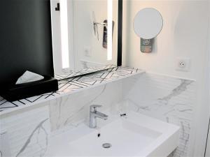 Salle de bains dans l'établissement Mercure Lyon Centre Brotteaux