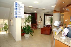 Лобби или стойка регистрации в Олимп Отель