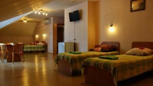 A bed or beds in a room at Tsarevna Lyagushka Hotel