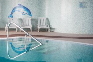 The swimming pool at or close to Vila Baleira Porto Santo
