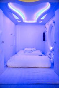 A bed or beds in a room at MET A Space Pod @ Chinatown