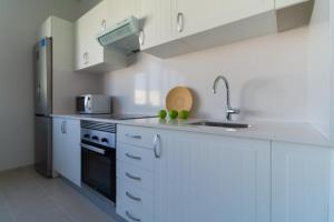 A kitchen or kitchenette at Apartamentos Bello Lanzarote