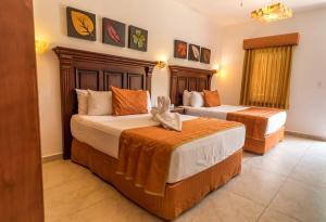 Een bed of bedden in een kamer bij Hotel Las Golondrinas