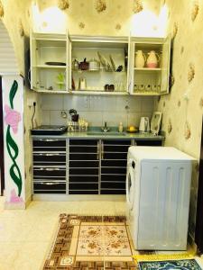 A cozinha ou cozinha compacta de Bahget Eljouf Furnished Apartment