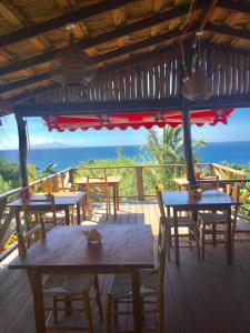 A restaurant or other place to eat at Tet Rouge Resort