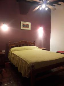 A bed or beds in a room at Hostal Rustyk