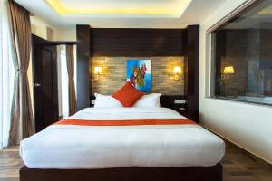 A bed or beds in a room at Bodhi Suites Boutique Hotel and Spa