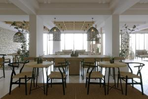 A restaurant or other place to eat at New Aqua Hotel