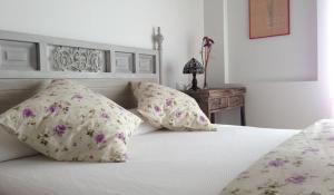Cama o camas de una habitación en Hotel Rural Salvatierra